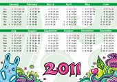 Calendar for 2011 with flowers and cute bunny. symbol of new year poster
