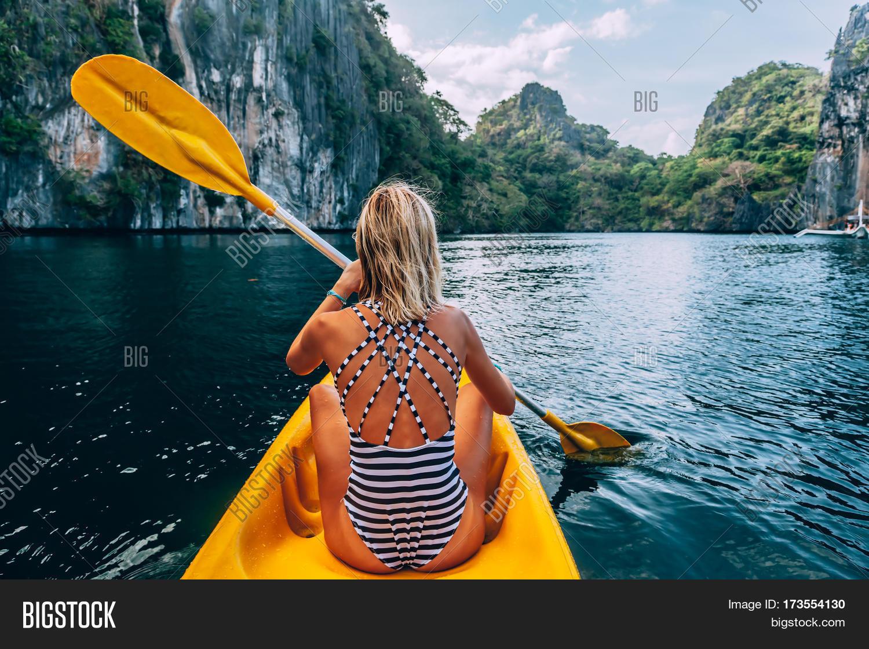 woman paddling kayak image photo free trial bigstock