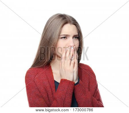 Young ill woman on white background
