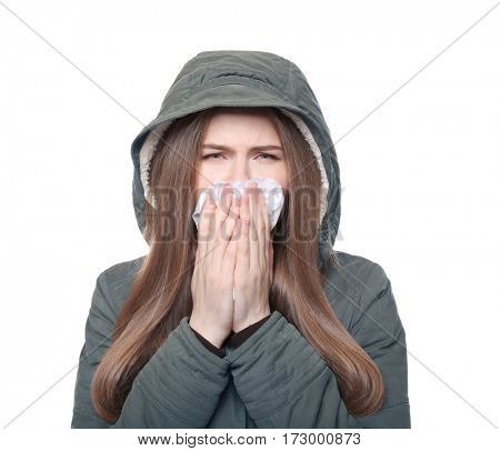 Young ill woman with tissue on white background
