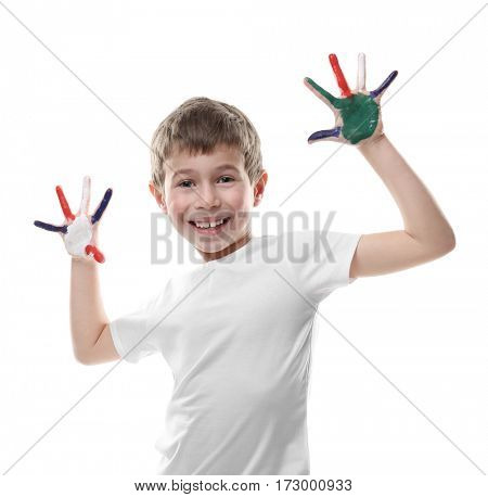 Little boy with hands in colorful paints isolated on white