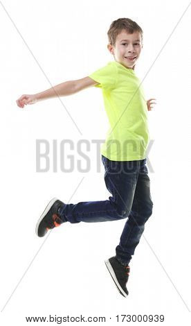 Portrait of jumping little boy isolated on white