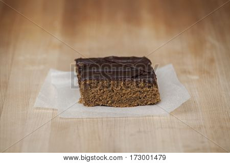 A sliced piece of ginger bread with chocolate frosting