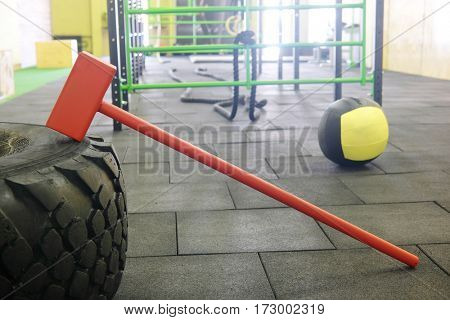 Fitnes hummer and truck tyre close up. One of the fashionable modern fitness trends is based on the enjoyment of the instruments from everyday life