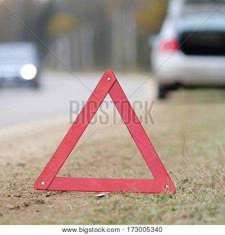 The image of an emergency sign on a road
