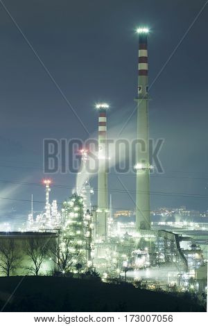 Night Scene Of Petronor Petrochemical Plant.