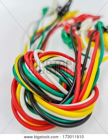 The colorful electrical cables. Isolated on white. Close-up