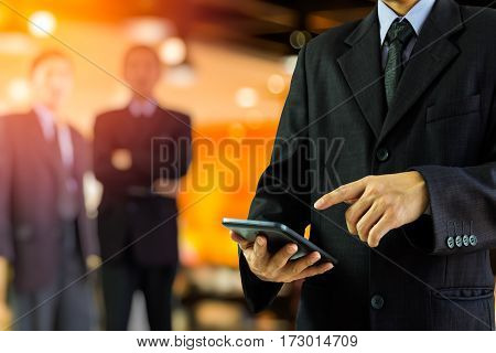Business Man. Business man using tablet research data for business planning. Two business man background. Business working and business people concept. Business man over sunny office and business people background business content.
