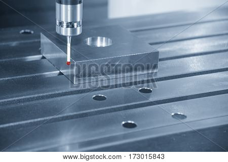 The measurement probe for measure the sample part on the CNC machine with the light blue scene