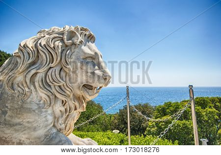 Marble lion statue in front of facade of Vorontsov palace in Crimea Russian Federation