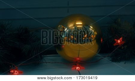 Christmas decorations - ball guerland and pine branches in the evening close up