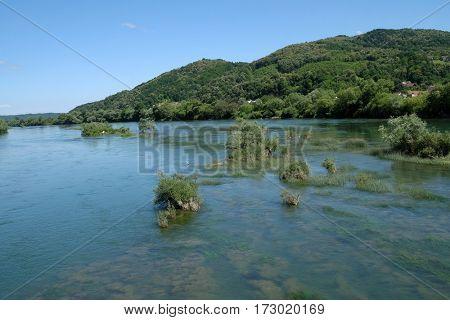 HRVATSKA KOSTAJNICA, CROATIA - JUNE 18: River Una on a summer day in Hrvatska Kostajnica, Croatia on June 18, 2016.