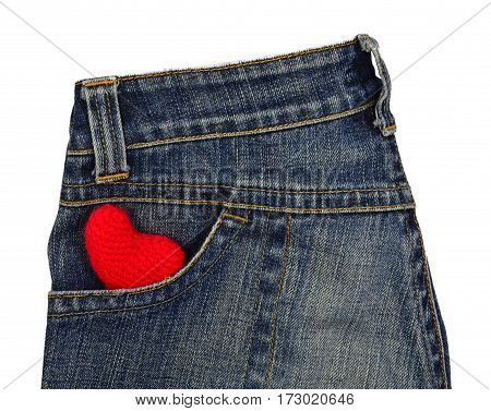 Blue jeans back pocket with red crochet heart on white background