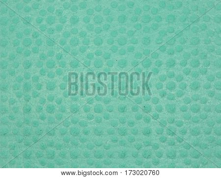 Texture of green cellulose sponge for background and texture