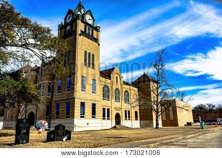 Prattville Alabama USA - January 28 2017: Clock tower of the Autauga County Courthouse with the memorials visible.