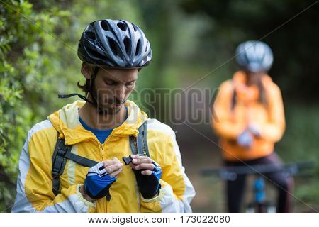Male biker with backpack in countryside