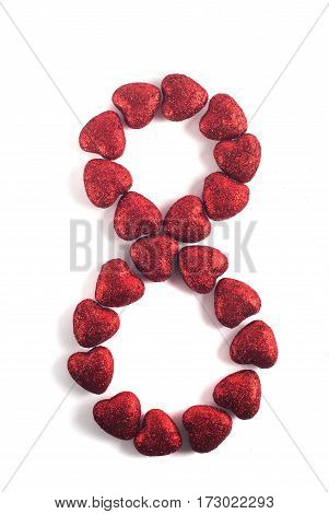 Decorative red heart isolated on white background, in the form of a figure eight, on March 8, international women's day