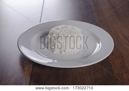 White Rice In Plate On Wooden Table