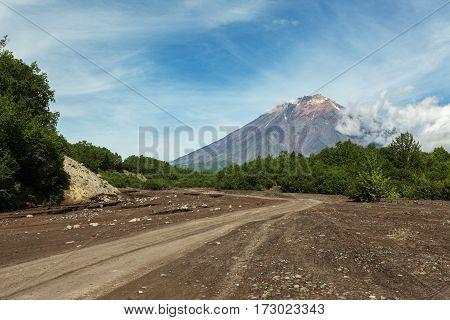 Road along the dry river to the Volcano Koryaksky 3456 m on the Kamchatka Peninsula