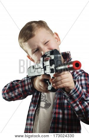 Little boy in shirt with a black gun, isolated on white background, boy posing, the man takes aim ,