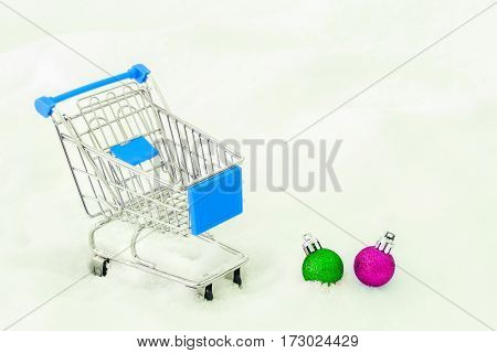 Cart from the grocery store on snow. Concept of winter shopping. New Year and Christmas buying. Retail trade and advertising. Business ideas.