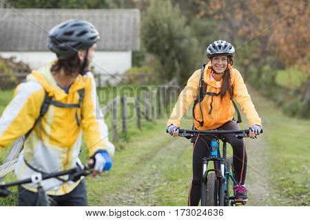 Biker couple cycling on a countryside track