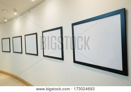 blank white picture frame on wall with nobody