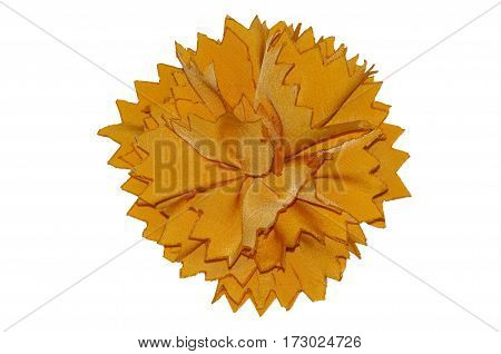 Flower from fabric of yellow color close up on a white background