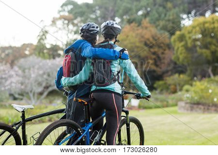 Biker couple with mountain bike in countryside