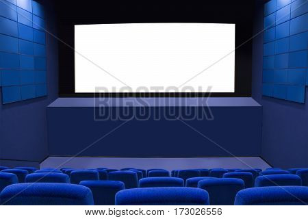 Cinema screen with blue seats and walls. Cinema theater without people. Empty cinema hall. White screen in the cinema. The interior of the cinema. Ready for adding your picture or text.