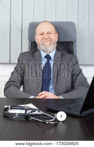 Picture of an elderly hospital manager at the office
