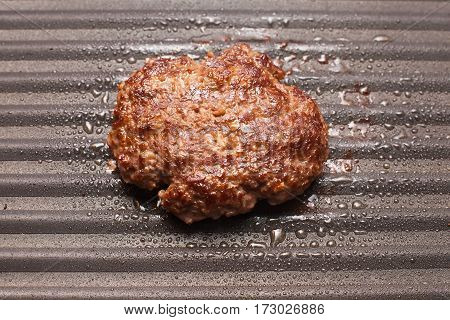 Close up picture of a fried hamburger meat