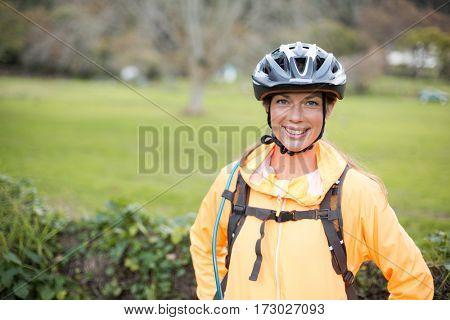 Portrait of female biker smiling in countryside