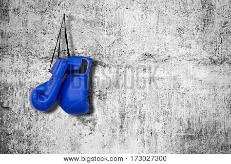Boxing gloves on the wall. Concept of sport.