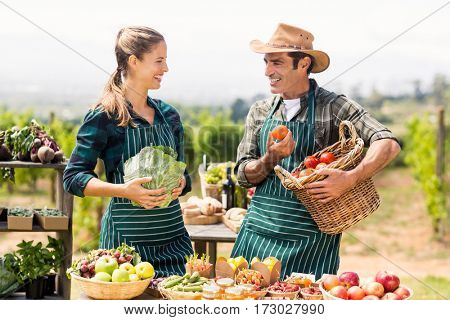 Farmer couple discussing with each other at local market