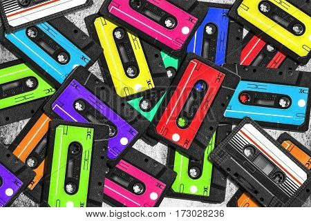 Old audio cassette. Multicolored audio tapes. Close-up view. The concept of old music. The era of retro songs. Isolated objects. large collection of retro cassette tapes. The music of yesteryear.