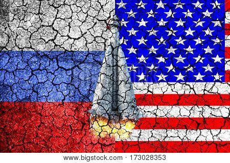 Flag of Russia and USA painted on the cracked wall. Concept of war. Cold war. The arms race. Nuclear war. The third world war. The conflict between Russia and America. Political concept. Front view.