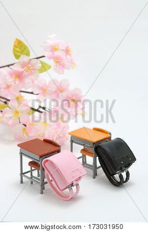 Schoolchild's rucksacks and cherry blossoms on white background. randoseru. School ceremony  concept.