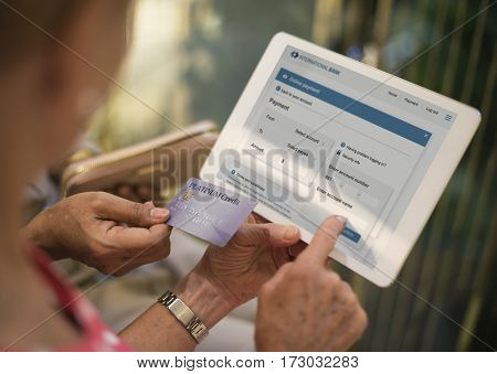Senior Women Use Tablet Online Payment