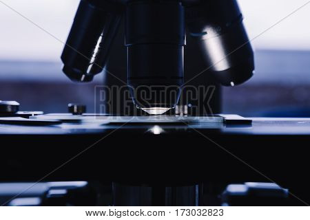 Modern microscope in the laboratory. Closeup shot.