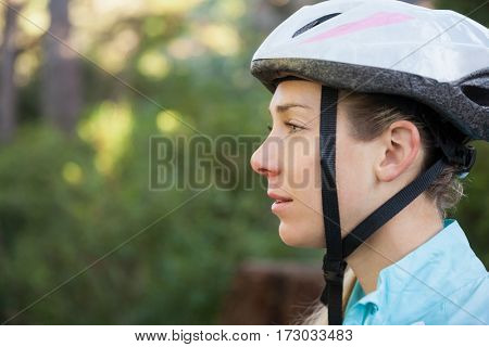 Close-up of female mountain biker in the forest