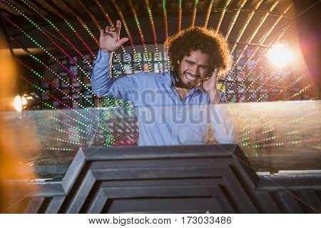 Male DJ playing music at the nightclub