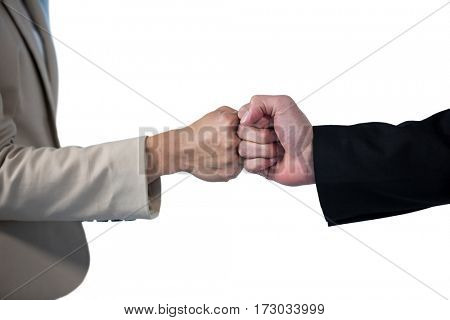 Business people giving fist bump on white background