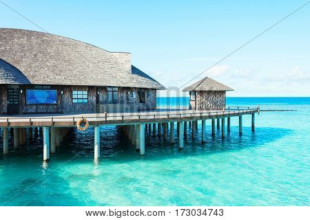 landscape of tropical sea with resort house in sunny blue sky