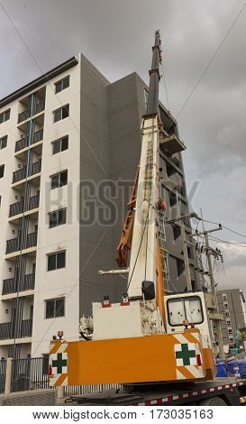 Crane Truck move object to a building in construction site