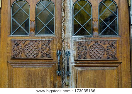 Detail Of Wooden Door With Lock At An Old Building