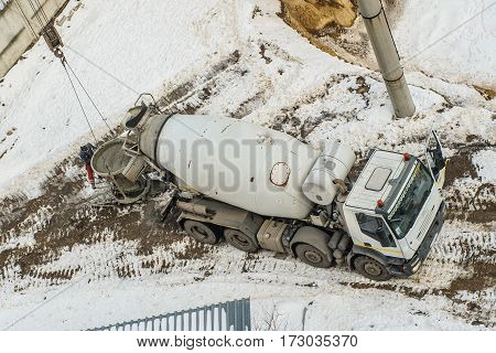 Concrete Mixer Truck Pouring Liquid Concrete Into The Tower Crane Bucket