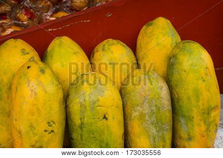Ripe Papayas with yellow skin displayed on red table in a fruit store photo taken in Depok Indonesia java