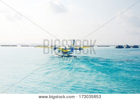 landscape of beautiful tranquil sea with seaplane in sunny sky