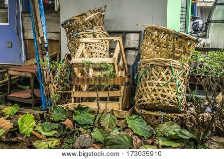 Mound of bamboo basket using for vegetable and fruit waste at traditional market photo taken in Depok Indonesia java